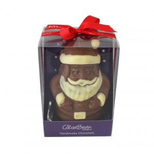 milk hocolate santa in a box with a ribbon