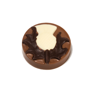 milk chocolate disc with dark and white chocolate thistle design