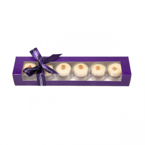 highland fudge cylinders in a purple box with ribbon