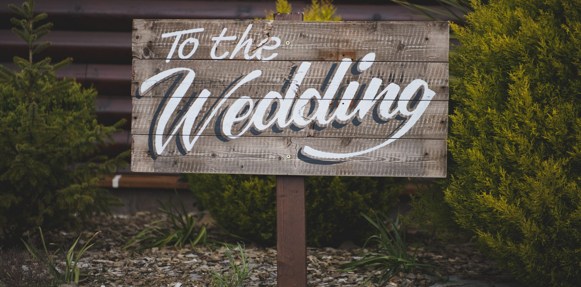 "wooden sign ""to the wedding"""