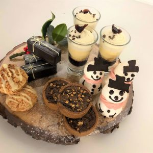 Festive desserts on a tree stump