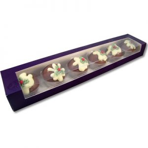 chocolates shaped liked christmas pudding in a purple box