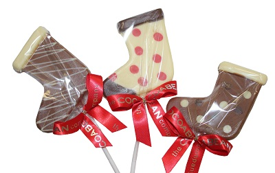 three chocolate lollipops in shape of stockings