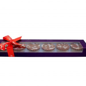6 chocolates in a purple box with orange ribbon