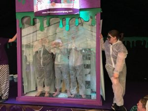 purple slime tank with children being slimed