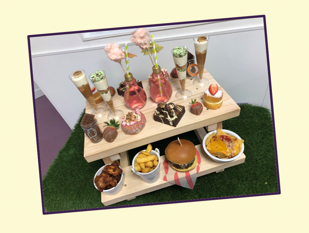 mini picnic bench with a selection of tasty food