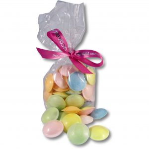 colourful flying saucer discs in cello bag with ribbon