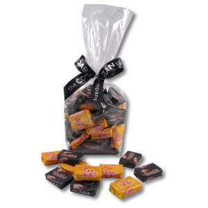 fruit salad and black chews in a cello bag with ribbon