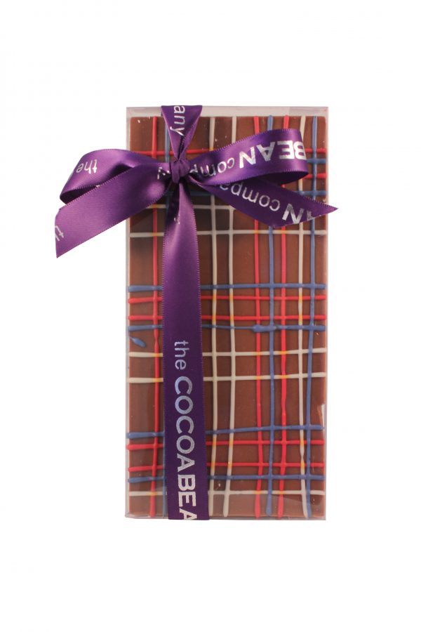 milk chocolate bar with coloured tartan pattern and ribbon