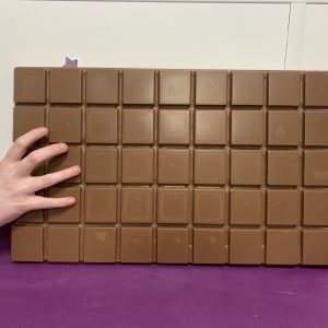 giant chocolate bar with hand