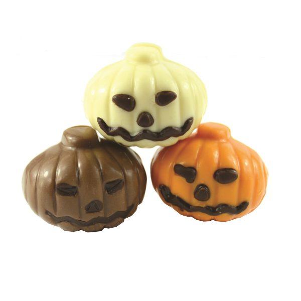 three chocolate pumpkins, milk, white and orange
