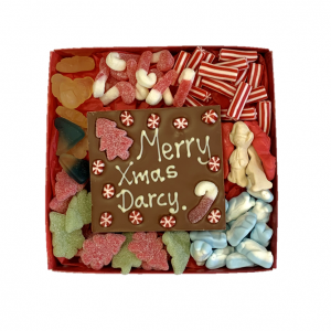 xmas sweets in a red box with personalised chocolate bar