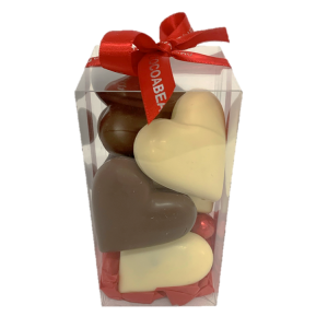 white and milk chocolate hearts in a gift box with red ribbon