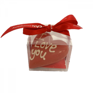single red heart made from chocolate inside a gift box with red ribbon