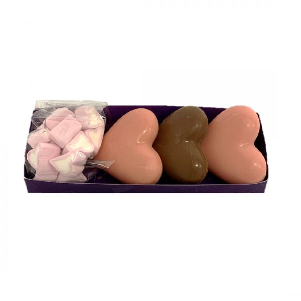 pink and milk chocolate heart shaped hot chocolate bombs with mini heart marshamallows