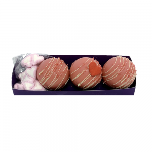 THREE PINK HOT CHOCOLATE BOMBS WITH MINI HEART SHAPED MARSHMALLOWS
