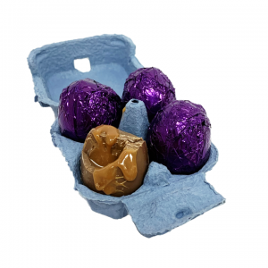 dippy chocolate eggs with caramel in blue egg carton