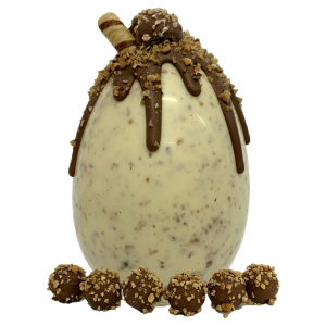 nut white chocolate easter egg with chocolate drips and hazelnut truffles