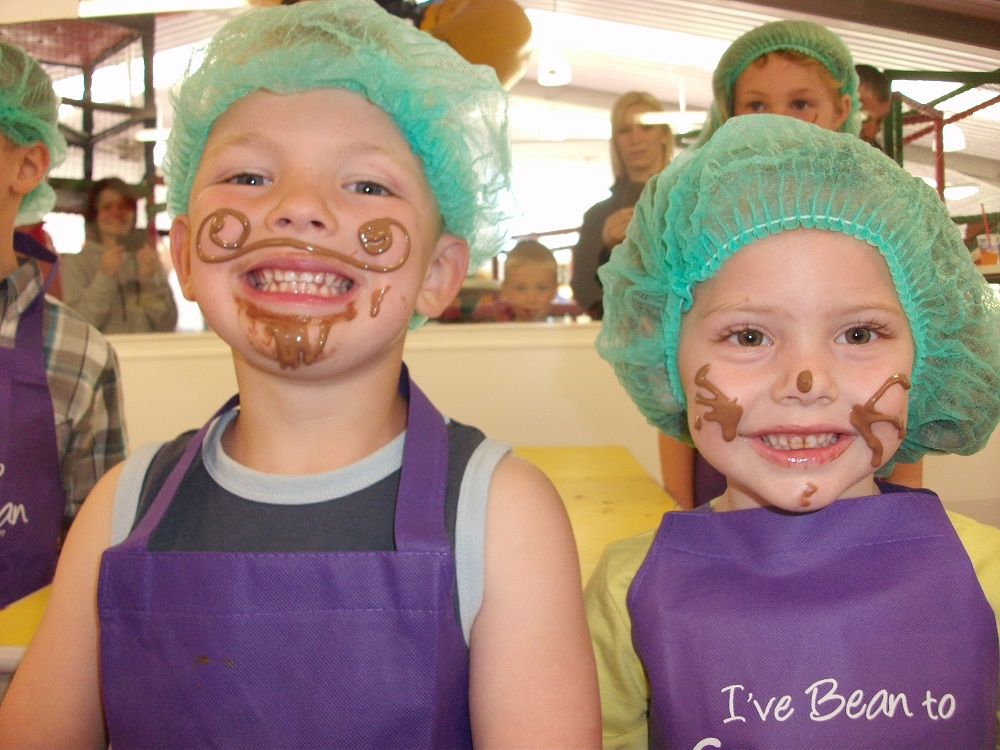 two children in a chocolate making workshop